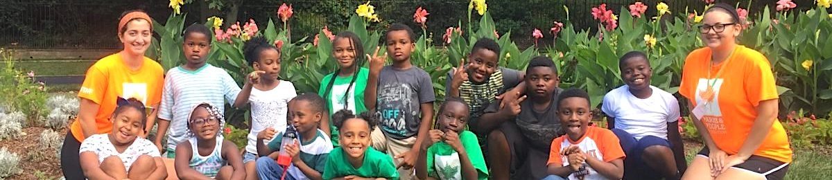 Students with youth who participate in the Parks and People Foundation's SuperKids Camp in Baltimore, Maryland.