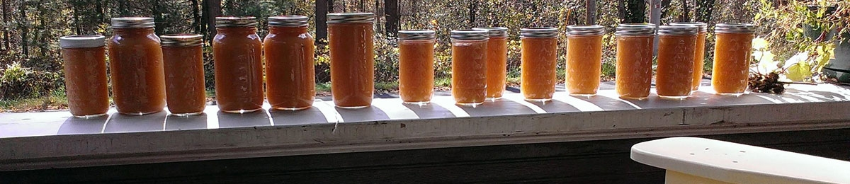 Applesauce jars on porch railing