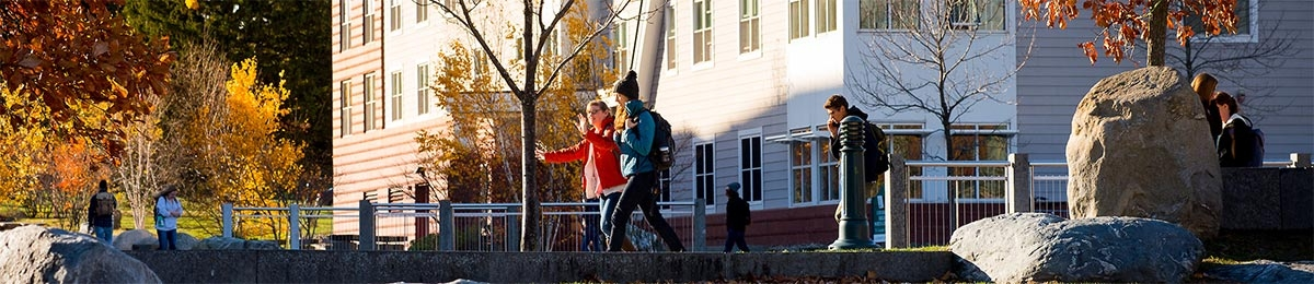 Univeristy Heights exterior with students walking on campus