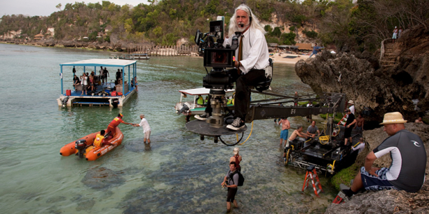 Cinematographer Robert Richardson mans camera on set over ocean