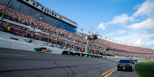 Presidential limo leads race cars around lap of the track at Daytona 500, 2020.