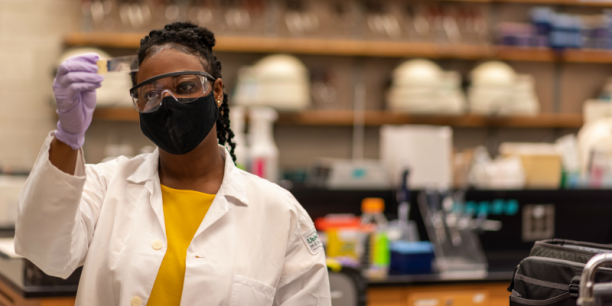 Medical laboratory science student looks at a biological specimen in a laboratory at UVM.