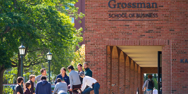 Students and faculty meet outside Kalkin Hall at the Grossman School of Business.