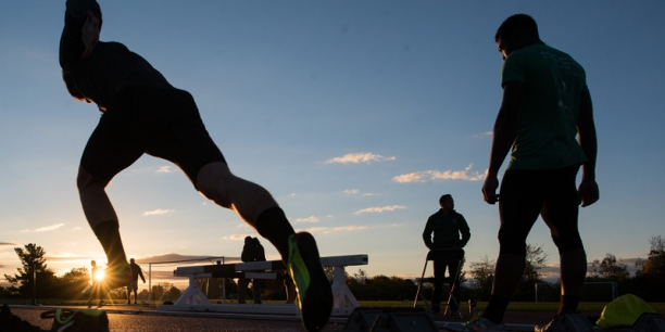 track runners at sunrise