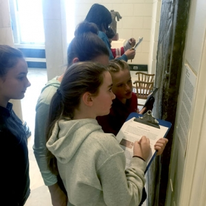 Students examine the Assyrian relief in the Museum's Marble Court