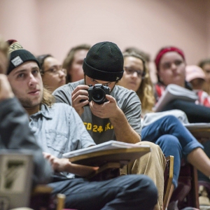 A student records an event in a lecture hall