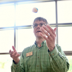 Staff Council Administrator Alan Shashok learning to juggle at the 2019 Annual Retreat.