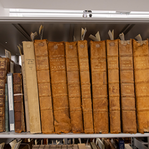 Old leather covered books on a shelf in the Howe Library special collections