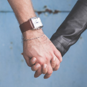Holding hands by wall