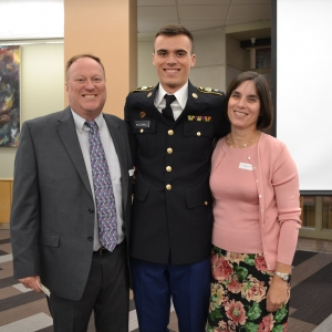 Connor MacDonald and his parents pose for a photo at the Alumni Reception.