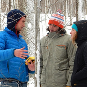 Students using GPS in forest