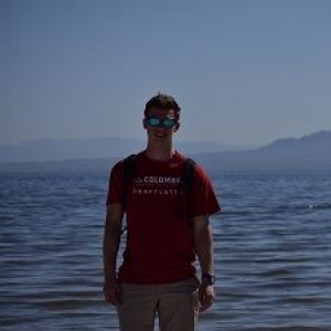 Trevor Mackowiak standing at a lake
