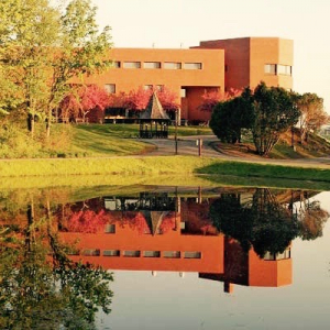 brick building overlooking a pond
