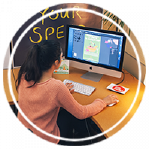 a student working at a desktop with illustrator open