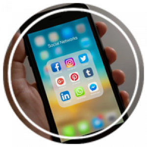 a hand holding a phone open to social media apps