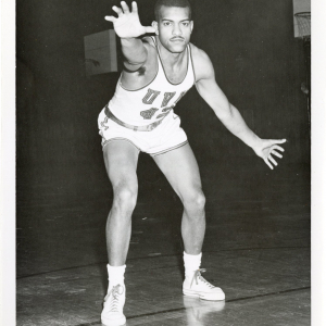 Richard Dennis in a defensive position in basketball uniform