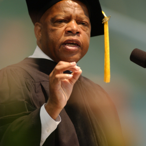 John Lewis in cap and gown speaking at podium