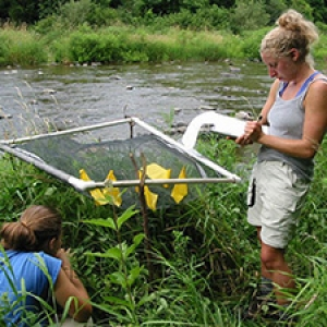 Two students conducting field sampling