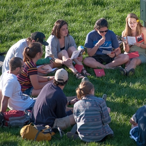 Students sitting together on the UVM green