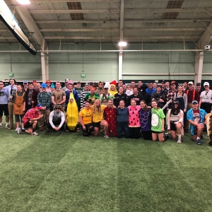 Green Mountain Battalion poses for a photo in all of their Halloween costumes at PT.