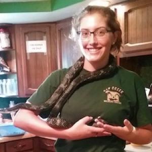 girl holding snake