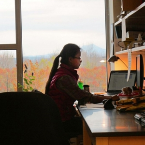 Student working at a desk for an internship.