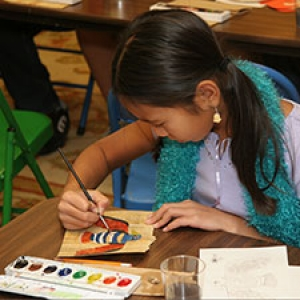 A young student takes part in an art activity class