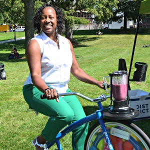 Person riding smoothie bike.