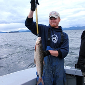 Studetnt holding whitefish