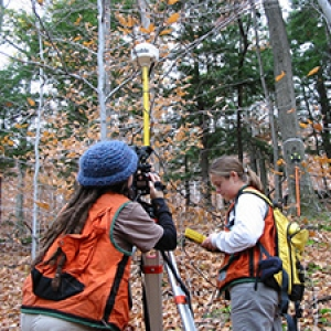 Two students doing forest measurements