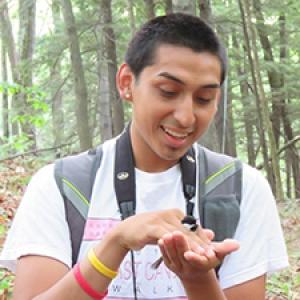 Student holding chickadee