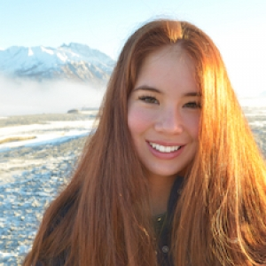 student in front of mountains