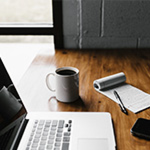 laptop computer and coffee cup