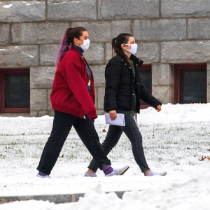 students walking on campus winter