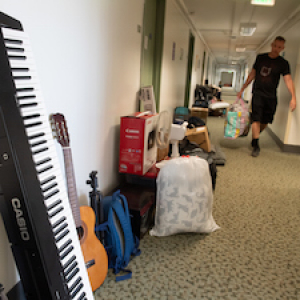 Dorm hall filled with student belongings