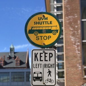 a uvm bus stop sign