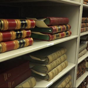 Books lay on shelves in the Vermont State Archives in Montpelier.