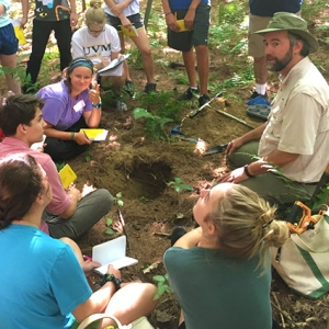 Walter Poleman demonstrates soil pit for students
