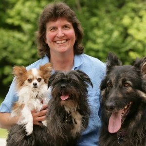 Jamie Shaw holding three dogs