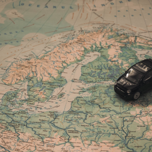 a map with a miniature car on it