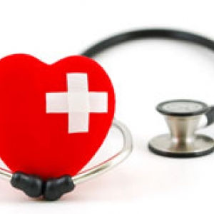 Heart with bandaid and stethoscope