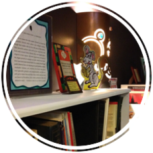 books, photos, poems, lights, awards, and notes line the bookshelves of the book nook