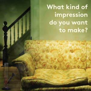 """An old flower upolstserly couch has a deep impression on it in a smoke filled room and the words """"what impression do you want to make?"""" appear over it"""