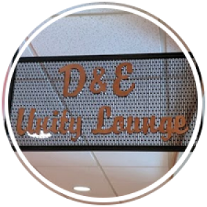 signage that says d & e unity lounge