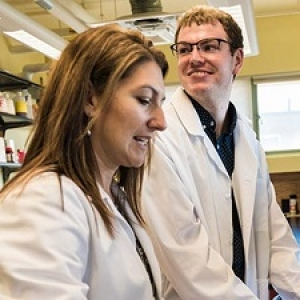 Professor Paula Deming and senior Tyler Hogan in the lab