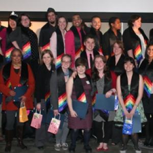 Students wearing rainbow regalia