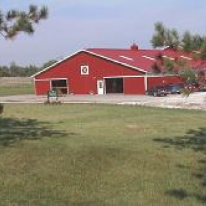view of UVM Horse Barn from the road