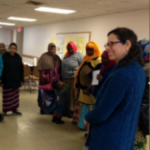 Linda Berlin with a Group of Resettled Refugee Families