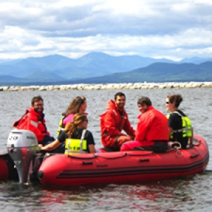 Researchers in an inflatable boat on lake