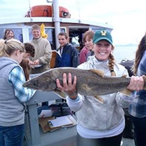 Student holding fish on Melosira